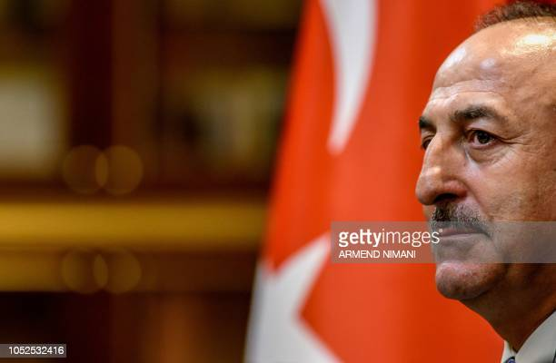 Turkish Foreign Minister Mevlut Cavusoglu looks on during a press conference with his Kosovo counterpart in Pristina on October 19 2018