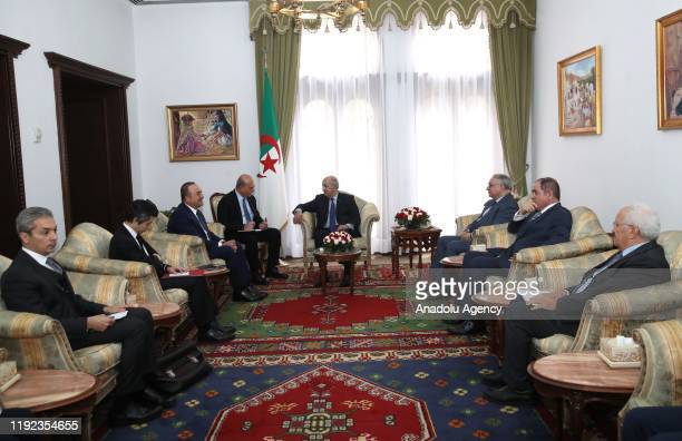 Turkish Foreign Minister Mevlut Cavusoglu meets President of Algeria Abdelmadjid Tebboune in Algiers Algeria on January 7 2020