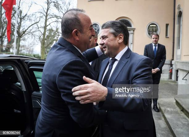 Turkish Foreign Minister Mevlut Cavusoglu meets with German Foreign Minister Sigmar Gabriel during his visit to attend the opening ceremony of 2018...