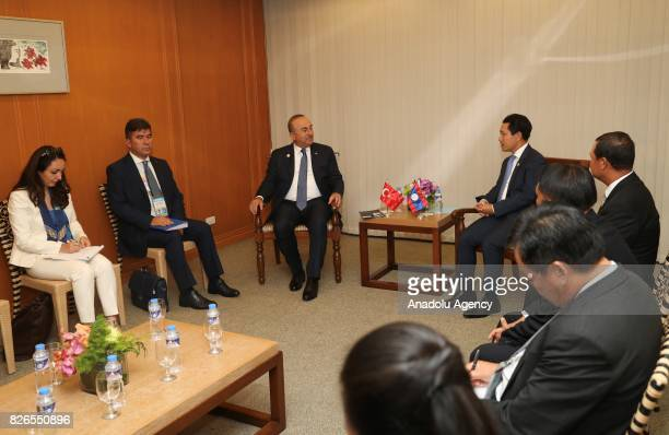 Turkish Foreign Minister Mevlut Cavusoglu meets with Minister of Foreign Affairs of Laos Saleumxay Kommasith within the 50th Association of Southeast...