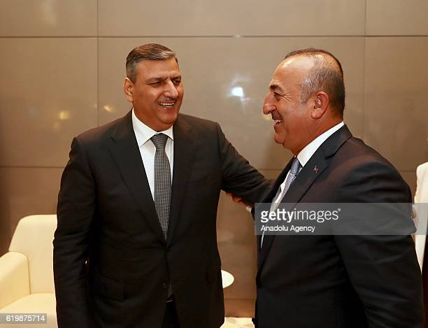 Turkish Foreign Minister Mevlut Cavusoglu meets with Riyad Hijab the General Coordinator of the Syrian High Negotiations Committee in Doha Qatar on...