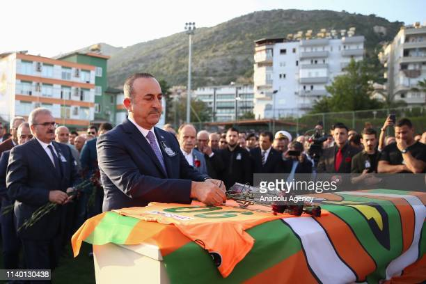 Turkish Foreign Minister Mevlut Cavusoglu places carnations on the coffin of Czech striker of Turkish football club Alanyaspor Josef Sural during a...