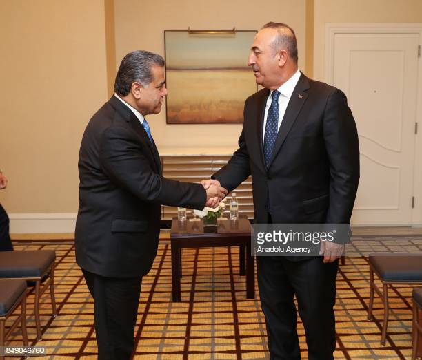 Turkish Foreign Minister Mevlut Cavusoglu shakes hands with Falah Mustafa Bakir Foreign Minister of the Iraqi Kurdish Regional Government ahead of...
