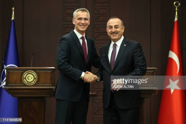 Turkish Foreign Minister Mevlut Cavusoglu shakes hands with NATO Secretary General Jens Stoltenberg during a joint press conference at Cankaya Palace...