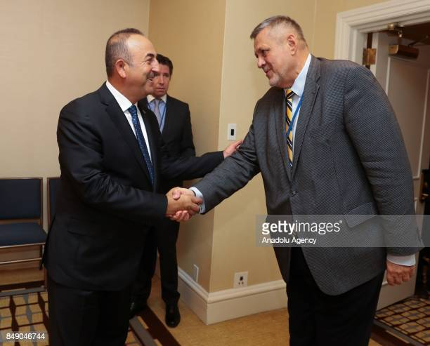 Turkish Foreign Minister Mevlut Cavusoglu shakes hands with Special Representative of the United Nations in Iraq Jan Kubis ahead of their meeting in...