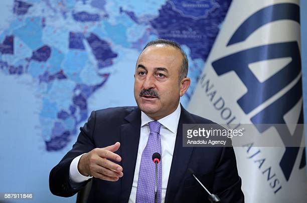 Turkish Foreign Minister Mevlut Cavusoglu speaks to journalists at Anadolu Agency in Ankara Turkey on August 10 2016