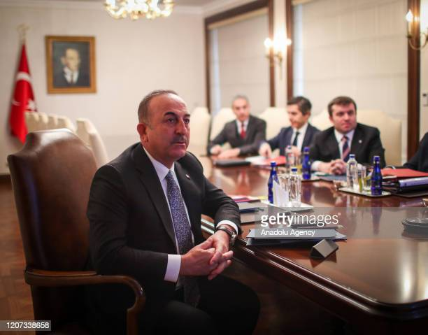 Turkish Foreign Minister Mevlut Cavusoglu speaks via teleconference with Chinese Iranian Iraqi and Italian Ambassadors and Consul Generals in Ankara...