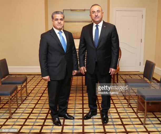 Turkish Foreign Minister Mevlut Cavusoglu stands next to Falah Mustafa Bakir Foreign Minister of the Iraqi Kurdish Regional Government ahead of their...