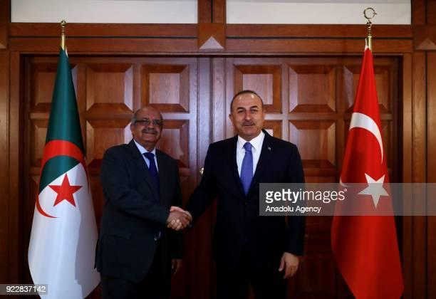 Turkish Foreign Minister Mevlut Cavusoglu welcomes Algerian Foreign Minister Abdelkader Messahel in Ankara Turkey on February 22 2018