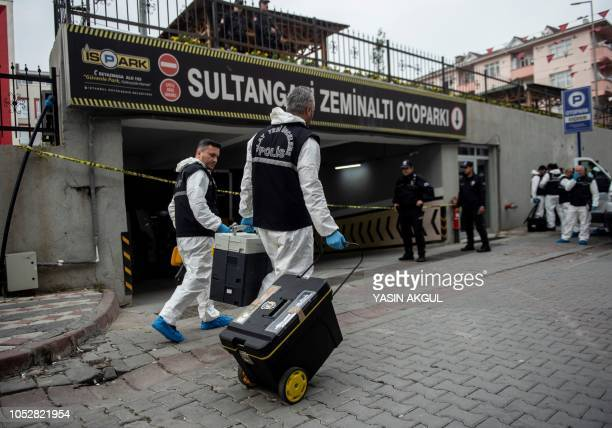 Turkish forensics arrive at an underground car park cordoned off by Turkish police after they found an abandoned car belonging to the Saudi consulate...