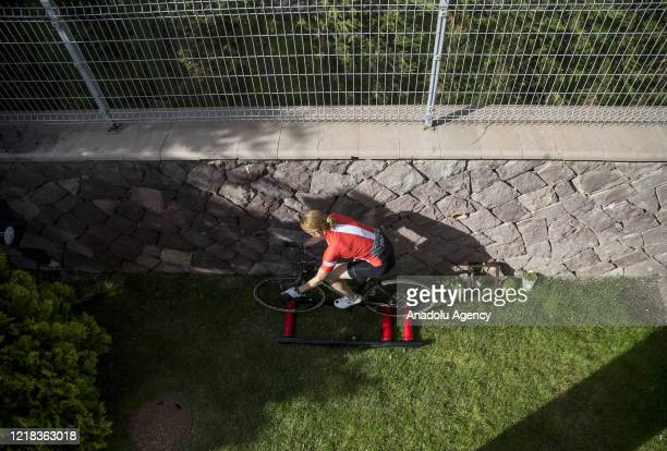 Turkish former national triathlete holding numerous Turkish records Pinar Avsar cycles during her training period to prevent loss of condition due to...