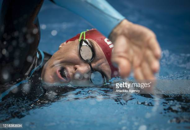 Turkish former national triathlete holding numerous Turkish records Pinar Avsar swims during her training period to prevent loss of condition due to...