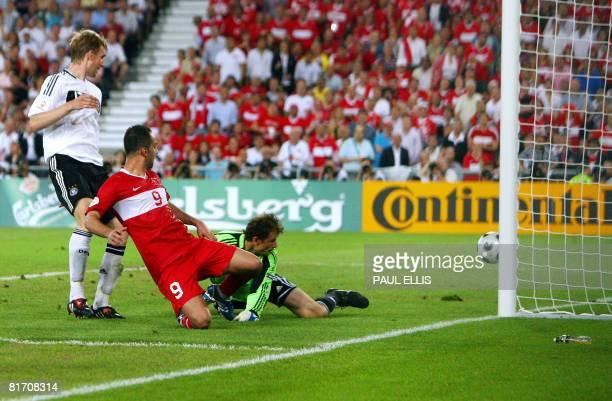 Turkish forward Semih Senturk deflects the ball past German goalkeeper Jens Lehmann to score during the Euro 2008 championships semifinal football...