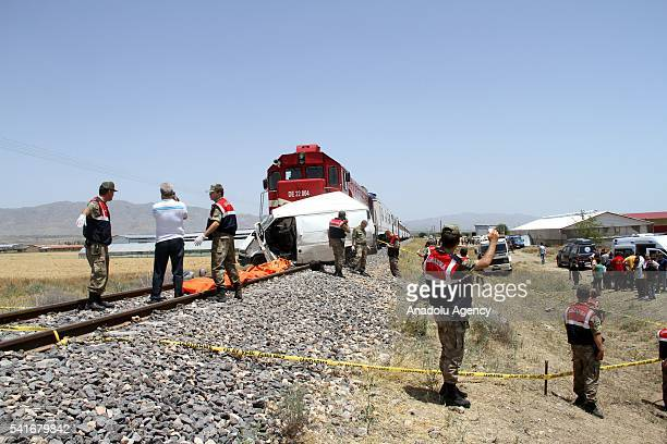 Turkish Gendarme Forces inspect the scene of an accident after a train hit a minibus at a level crossing killing nine people in Elazig Turkey on June...