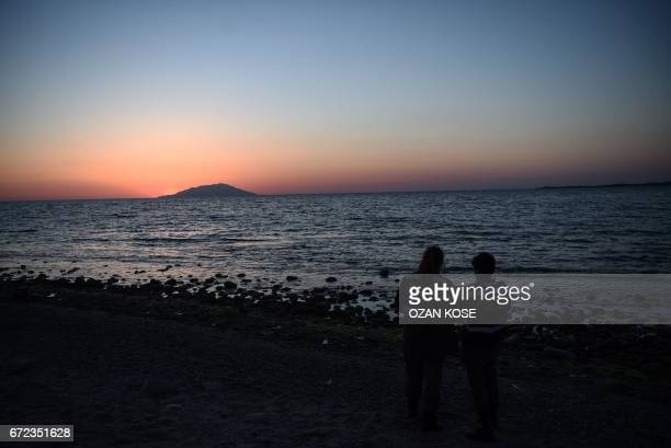 Turkish gendarme officers stand next to the Anzac cove on April 24 at sunset, in Canakkale, before a ceremony marking the 102th anniversary of the...