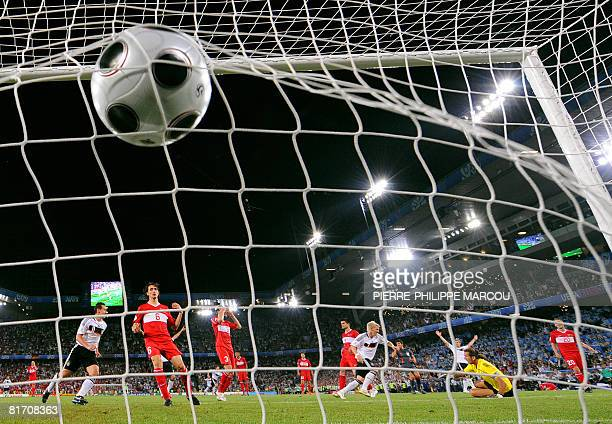 Turkish goalkeeper Rustu Recber faisl to stop a ball kicked by German defender Philipp Lahm during the Euro 2008 championships semifinal football...