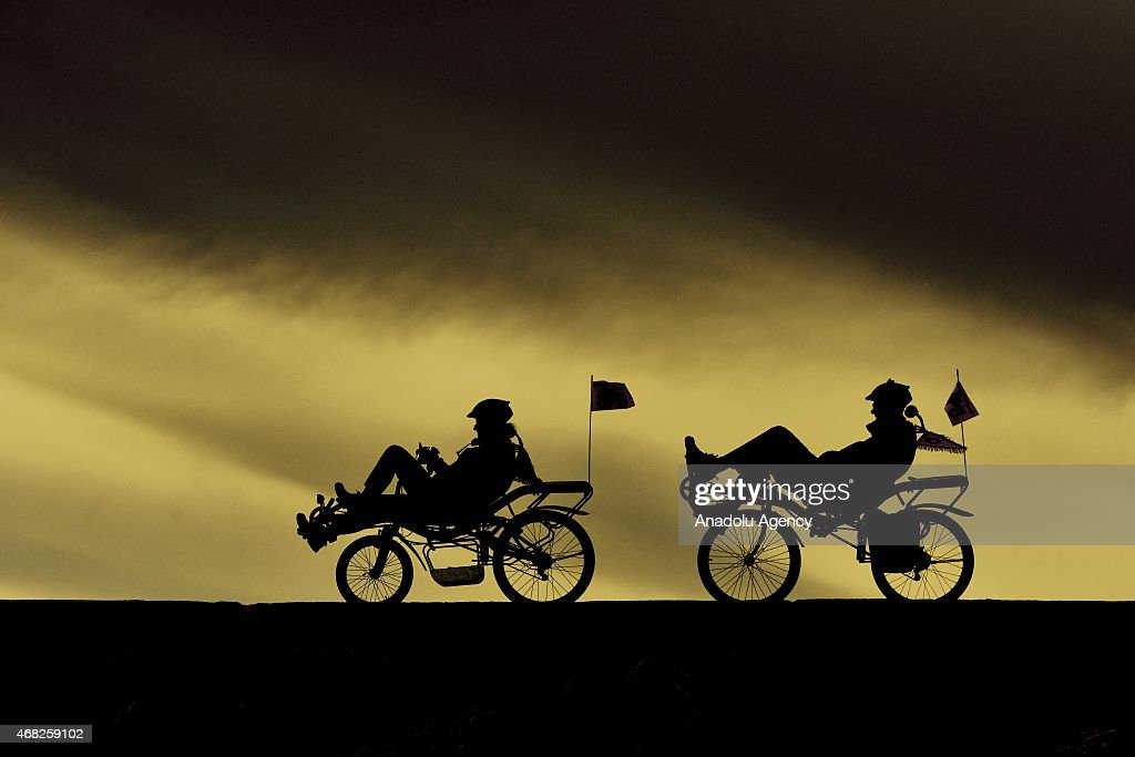 Turkish Gokben Bagci and her French husband Nicolas Ayme are seen on recumbent bikes in Van, eastern Turkey on March 27, 2015. The couple plans to travel around the world on their recumbent bikes for 4 years.