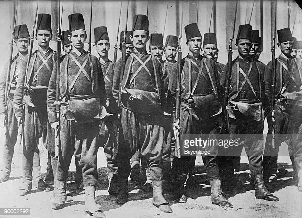 Turkish Guard with Rifles Wearing Fez's are in Platoon Formation in the Ottoman Empire