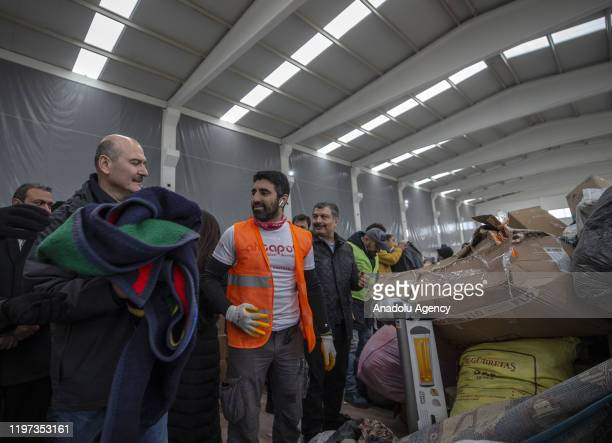Turkish Interior Minister Suleyman Soylu and Turkish Health Minister Fahrettin Koca help to pack the food aids prepared to dispatch to the earthquake...