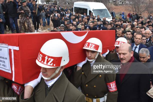 Turkish Interior Minister Suleyman Soylu carries the flagdraped coffin of Infantry Sergeant Enes Sariaslan who was martyred within the 'Operation...
