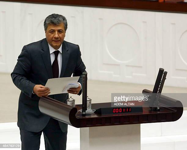 Turkish journalist Mustafa Balbay arrives to take his office oath at the Turkish Parliament in Ankara on December 10 2013 Balbay has been released on...