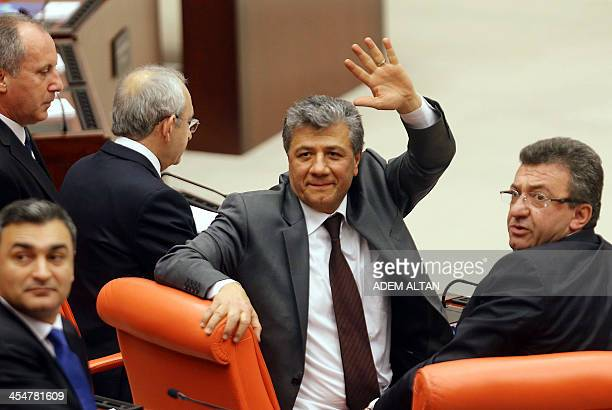 Turkish journalist Mustafa Balbay gestures as he sits at the Turkish Parliament in Ankara on December 10 2013 Balbay has been released on December 9...