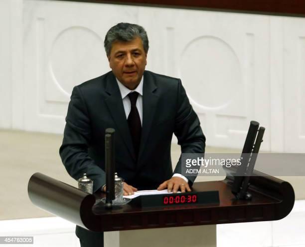Turkish journalist Mustafa Balbay takes his office oath at the Turkish Parliament in Ankara on December 10 2013 Balbay has been released on December...