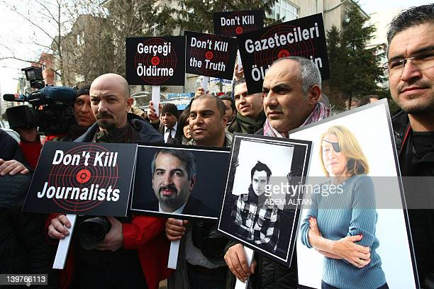 Turkish journalists in Ankara on February 24 hold pictures of journalists who died covering the crisis in Syria New York Times correspondent Anthony...
