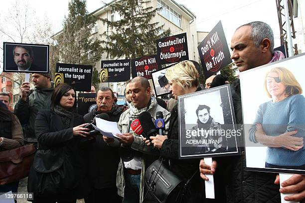 Turkish journalists in Ankara on February 24 hold pictures of journalists who died covering the crisis in Syria French photojournalist Remi Ochlik...