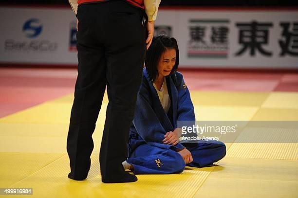 Turkish judoka Ebru Sahin gestures after getting injured during his fight against Russian judoka Natalia Kondratyeva in the women's 48kilogram...