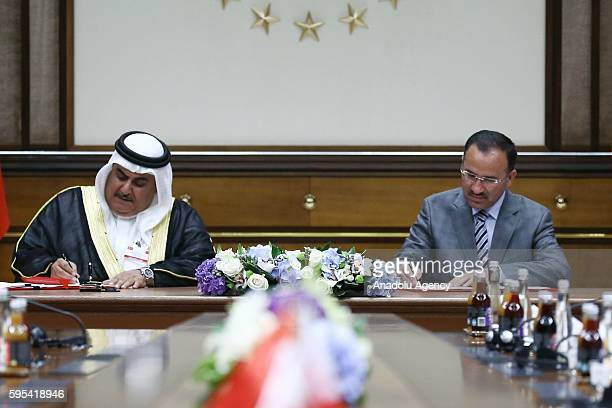 Turkish Justice Minister Bekir Bozdag and Bahraini Shaikh Khalid bin Ahmed Al-Khalifa sign an agreement during an Inter-Committee Meeting at Turkish...
