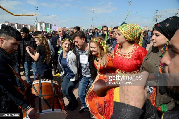 TOPSHOT Turkish Kurds dance as they gather for Newroz celebrations for the new year in Diyarbakir southeastern Turkey on March 21 2017 Newroz is an...