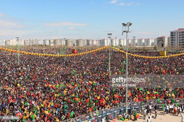 Turkish Kurds gather during Newroz celebrations for the new year in Diyarbakir southeastern Turkey on March 21 2017 Newroz is an ancient Persian...