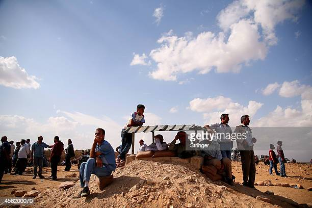 Turkish Kurds gather to see the fighting between the Islamic State fighters and the Protection of the Kurdish people fighters in the next village on...