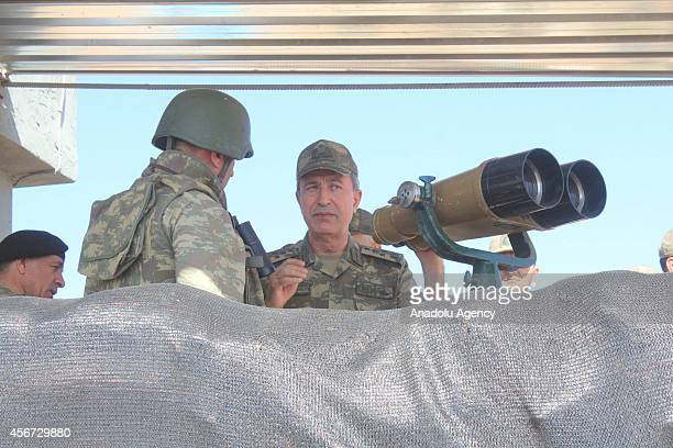 Turkish Land Forces Commander General Hulusi Akar appraises the situation on the Syrian border as a Turkish soldier informs him about the clashes in...