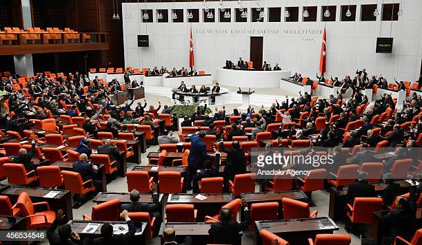 Turkish lawmakers authorize the government to deploy troops to Syria and Iraq to fight any group threatening the country on October 2 2014 at Turkish...