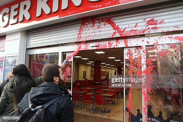 Turkish leftist students throw red ink at a Burger King restaurant on January 23 2015 in Ankara A Syrian refugee child has been beaten by a Burger...
