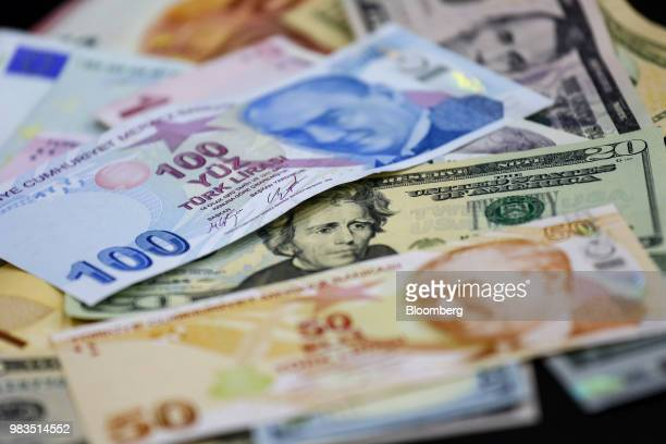 Turkish lira and dollar banknotes sit in this arranged photo at a currency exchange bureau in Istanbul Turkey on Monday June 25 2018 The gains in...