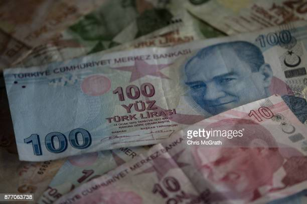 Turkish Lira currency is seen on November 21 2017 in Istanbul Turkey The Turkish Lira plunged to a record low of 3978 against the dollar in early...