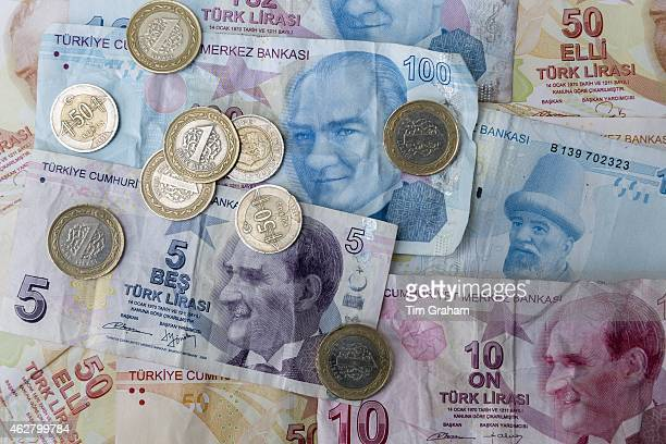 Turkish lira Turk Lirasi local currency coins and banknotes featuring image of Ataturk in Republic of Turkey