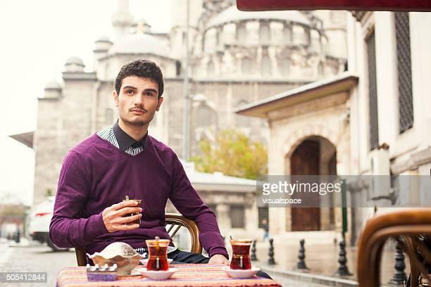 Turkish Man Enjoying Traditional Tea In A Sidewalk Cafe