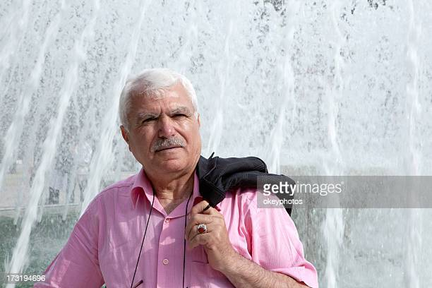 turkish man infront of a fountain - hairy old man stock pictures, royalty-free photos & images