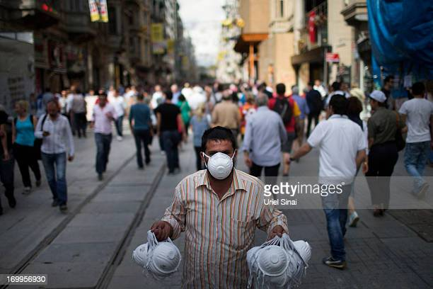 Turkish man sells masks on the streets after antigovernment demonstrations on June 5 2013 in Istanbul Turkey The protests began initially over the...