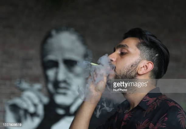 Turkish man smokes a shisha in a hookah bar in Esenyurt, Istanbul, Turkey on July 27, 2020. Turkish authorities have now allowed the reopening of...