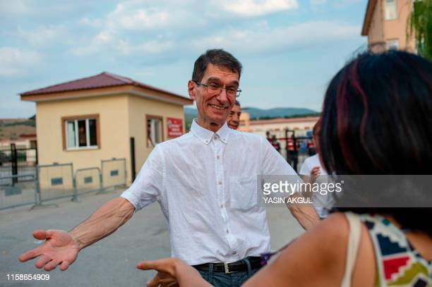 Turkish mathematician Tuna Altinel is greeted by a friend after his release from Kepsut prison in Balikesirl western Turkey on July 30 2019 Tuna...