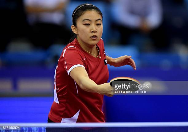 Turkish Melek Hu returns the ball to Portuguese Fu Yu in Tuskecsarnok sports hall of Budapest on October 23 2016 during the women final of LIEBHER...