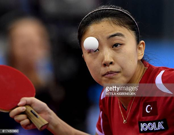 Turkish Melek Hu serves the ball to Portuguese Fu Yu in Tuskecsarnok sports hall of Budapest on October 23 2016 during the women final of LIEBHER...