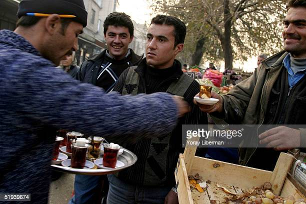 Turkish men get their morning tea in the street December 4 2004 in Gaziantep Turkey Small businesses are very common on the streets of Gaziantep...