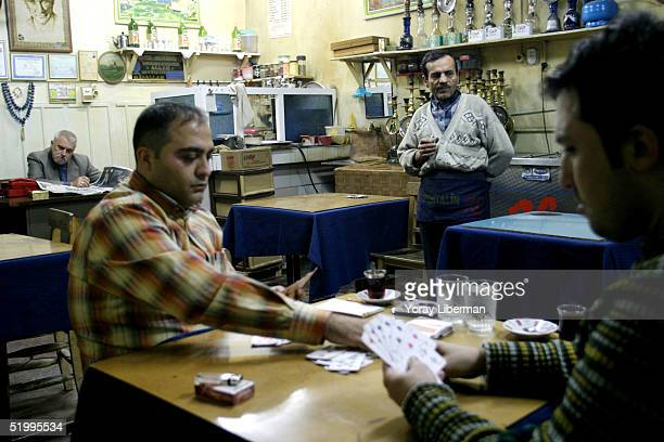Turkish men spend their evening in a traditional cafe December 4 2004 in Gaziantep Turkey Traditionally Turkish men go out to play cards drink Chai...