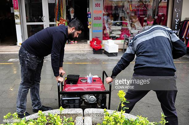 Turkish men try to start a generator on March 31 in Istanbul after a massive power cut caused chaos Tuesday in large parts of Turkey shutting down...